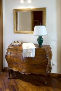 A bed or beds in a room at Accademia Residence