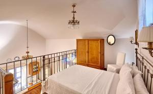 A bed or beds in a room at Orelia Cretan Villas