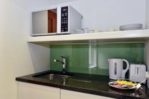 A kitchen or kitchenette at Arch Hotel