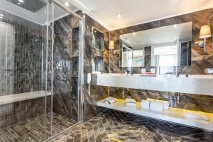 A bathroom at Ramada by Wyndham Sofia City Center