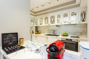 A kitchen or kitchenette at Ramada by Wyndham Sofia City Center