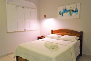 Кровать или кровати в номере Pousada Spadart