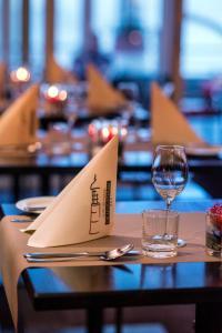 Ein Restaurant oder anderes Speiselokal in der Unterkunft Hotel De Leugenaar