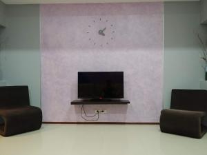 A television and/or entertainment center at Deluxe A401