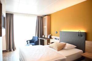 Ein Bett oder Betten in einem Zimmer der Unterkunft Engimatt City & Garden Hotel
