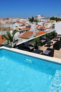 A piscina em ou perto de Authentic Tavira Hotel