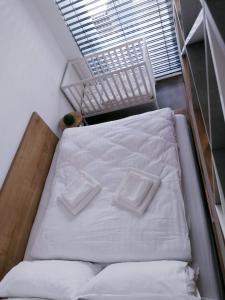 Posteľ alebo postele v izbe v ubytovaní Green Bay Residence Apartment C3.03