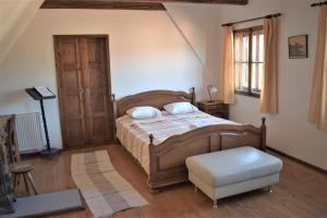 A bed or beds in a room at Casa Cojo