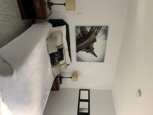 A bed or beds in a room at Motel Cle O Spa Inn