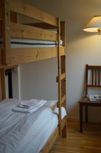 A bunk bed or bunk beds in a room at Turistgården - House Of Ven