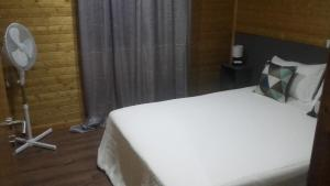 A bed or beds in a room at Douro Camping