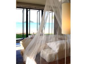 Ein Bett oder Betten in einem Zimmer der Unterkunft Seavana Koh Mak Beach Resort