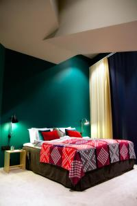 A bed or beds in a room at Bo Hotel