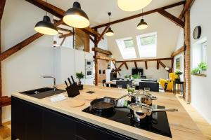 Kuchyňa alebo kuchynka v ubytovaní Loft v historickom centre
