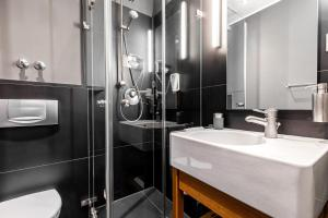A bathroom at YoHo - The Young Hotel