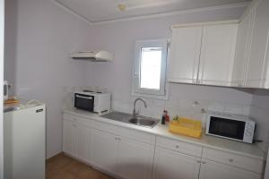 Η κουζίνα ή μικρή κουζίνα στο Ξενοδοχείο Στέλλα