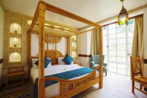 A bunk bed or bunk beds in a room at Small World Country Club