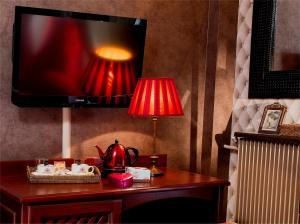 A kitchen or kitchenette at Hotel Britannique