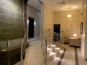 Uma área de estar em ماروم للشقق الفندقية