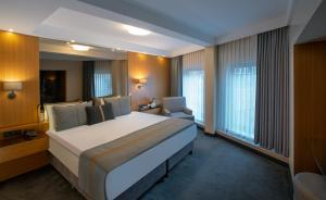 A bed or beds in a room at Tan Hotel - Special Category