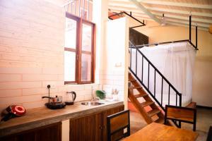 A kitchen or kitchenette at BoHo Hiriketiya