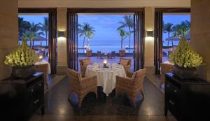 A restaurant or other place to eat at The Legian Bali