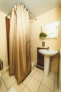 Ванная комната в Hotel Berezka