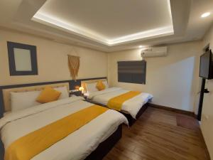 A bed or beds in a room at Bonjour Sa Pa Hotel