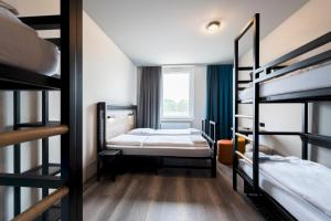 A bunk bed or bunk beds in a room at a&o Stuttgart City