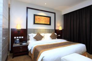 Cama ou camas em um quarto em Boudl Al Tahlia