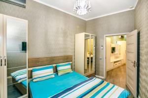 Cama ou camas em um quarto em Apartment near Nizami street and Boulevard