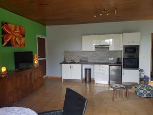 A cozinha ou cozinha compacta de Sanny Lodge Tahiti
