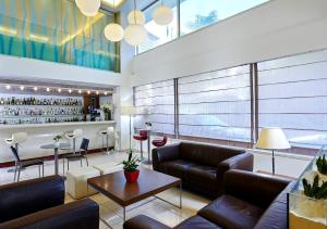 The lounge or bar area at Atrion Hotel