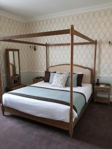 A bed or beds in a room at Best Western Moore Place Hotel