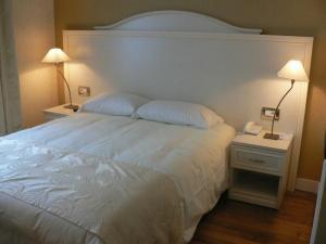 Un ou plusieurs lits dans un hébergement de l'établissement Hôtel Vauban