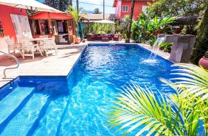 The swimming pool at or close to Pousada Palmeira Imperial