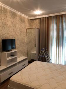 Cama ou camas em um quarto em NEM McDonald,s 2 bedroom Apartment