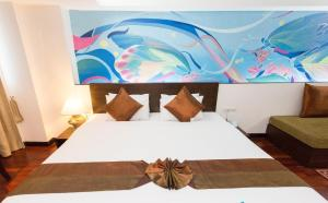 A bed or beds in a room at The Grand Sathorn