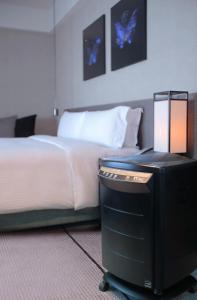 寒舍艾麗酒店房間的床