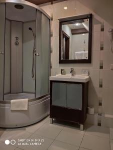 A bathroom at Domino Hotel