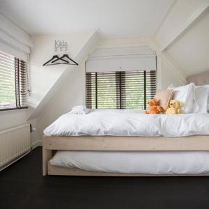 Een bed of bedden in een kamer bij Zenzez Hotel & Lounge