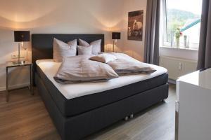Ein Bett oder Betten in einem Zimmer der Unterkunft Luxus Ferienwohnung Mein kleines Edelweiss