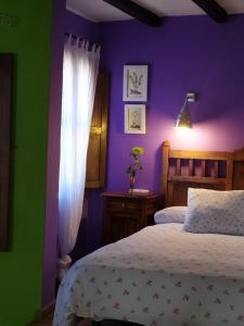 Cama o camas de una habitación en Apartamentos La Iguana