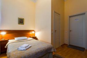 Łóżko lub łóżka w pokoju w obiekcie Baskov
