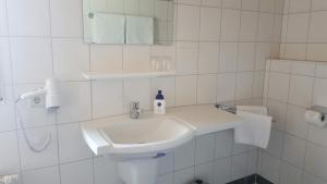 A bathroom at Pension Villaggio