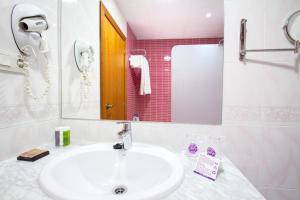 Een badkamer bij Hotel Servigroup La Zenia