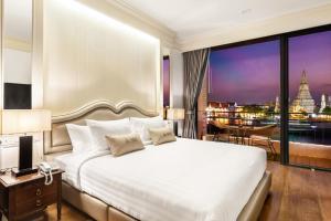 Letto o letti in una camera di ARUN Riverside Bangkok