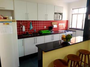 A cozinha ou cozinha compacta de Casa Babilonia
