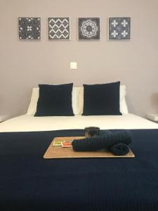 A bed or beds in a room at LA VILLA M
