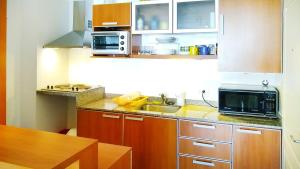 Una cocina o kitchenette en Gorgeous Studio with rooftop pool, gym and laundry - Corrientes Ave